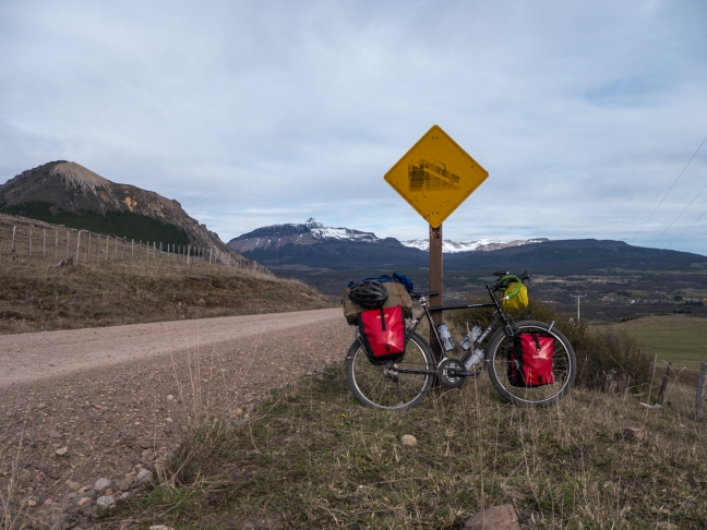 End of the pass at 100km, and right before Villa Ortega.